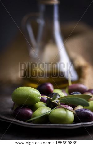 Still life with olives and olive oil