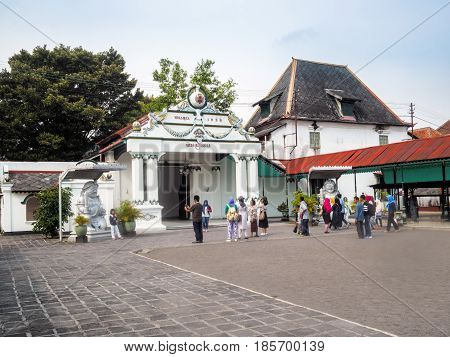 Yogyakarta Indonesia - September 15 2016: Tourists are entering the main entrance of Palace of Sultan of Yogyakarta the former ruler of Indonesia before the Dutch colonization of Indonesia.