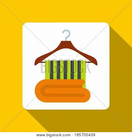Green towel on on a wooden coat hanger icon. Flat illustration of green towel on on a wooden coat hanger vector icon for web