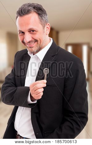 Male Realtor Showing The Keys Of An Apartment