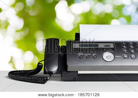 Fax machine communication on the white table