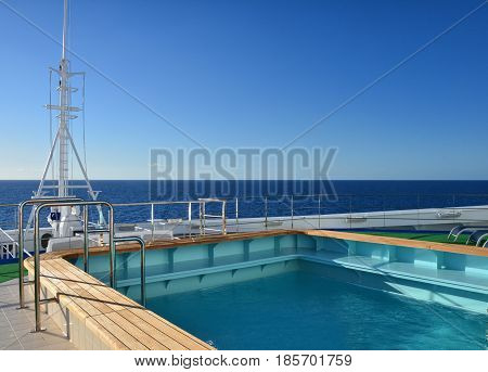 CARIBBEAN SEA - MARCH 29 2017 : Swimming pool on the bow of Royal Princess ship. Royal Princess is operated by Princess Cruises line and has a capacity of 3600 passengers