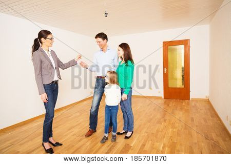 realtor giving a family the key to their new apartment