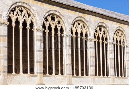 The traceried windows of the Cemetery (Camposanto) on the Square of Miracles (Piazza dei Miracoli) in Pisa, Tuscany, Italy