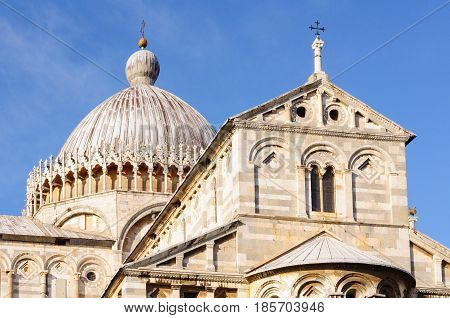 Greek crosses on the roof and dome of the Pisa Cathedral (Duomo) - Pisa, Tuscany, Italy