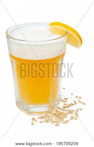 Light unfiltered beer with foam isolated on white