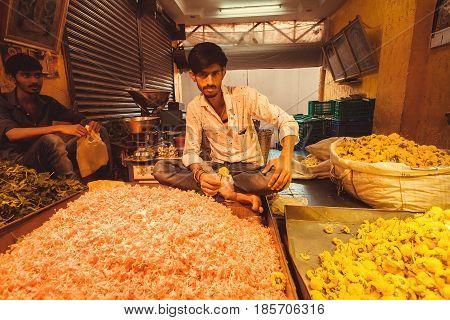BANGALORE, INDIA - FEB 14, 2017: Young traders of the Flower Market of indian city on February 14, 2017. With population 8.52 million Bangalore is 3rd most populous indian city