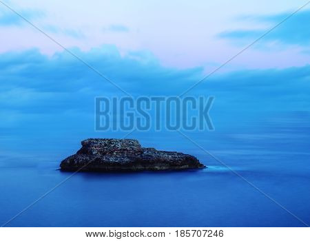 Lonely islet in blue sea mediterranean and sky