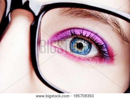 Image Of A Beautiful Young Woman Wearing Glasses. Bright Makeup.