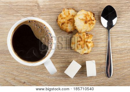 Black Coffee In Cup, Coconut Cookies, Lumpy Sugar And Spoon