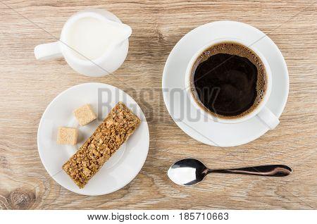 Black Coffe In Cup, Jug Of Milk, Granola Bar