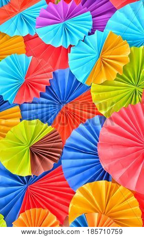 Background of colorful paper fans Artistic background