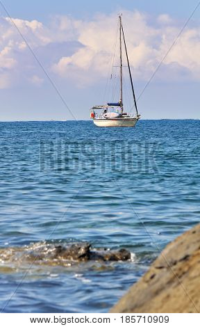 sailboat at the skyline in blue sea