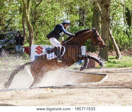 BURNHAM MARKET NORFOLK/ENGLAND - APRIL 15th 2017: Burnham Market International Horse Trials 2017 cross country event Alexander Bragg