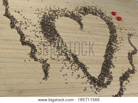 Chia seeds with red hearts/ This is a chia seeds background.