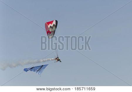 Bellaria Italy - June 05 2016: View of a man piloting a paramotor