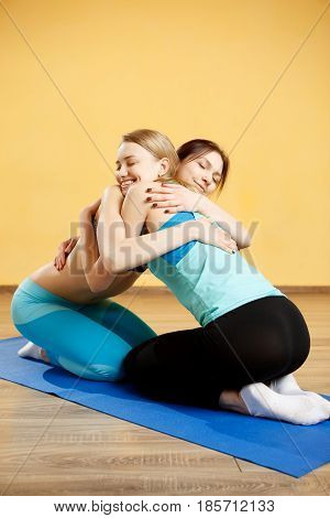 Photo of women in gym doing yoga