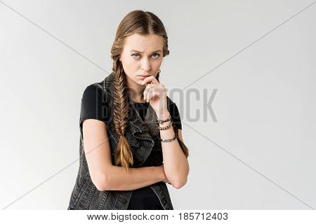 Portrait Of Pensive Blonde Rocker Girl With Braids Looking At Camera Isolated On Grey