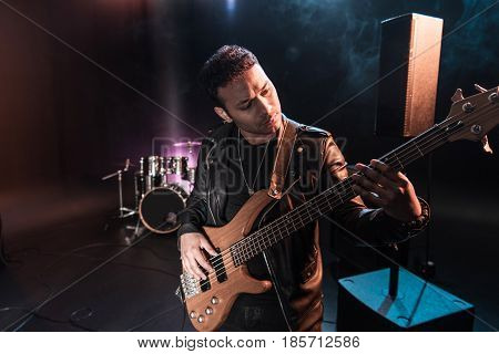 Electric guitar player performing hard rock music with bass guitar on stage