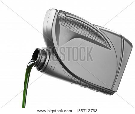 The oil for the engine flows the open plastic canister the green motor grease with molygen