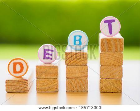 Stack of wood in debt concept in debt concept