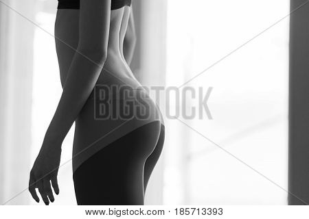 Black and white photo of sports girl in sports hall