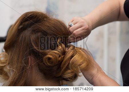 Professional Hairdresser Making Curls. Beauty And Haircare Concept