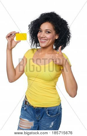 Smiling mixed race african american caucasian woman holding credit card and gesturing thumb up, isolated on white background
