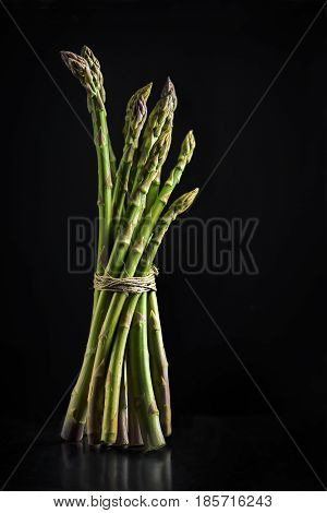 Fresh asparagus isolated on black background with copyspace