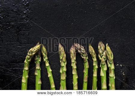 Fresh green asparagus on rustic black board