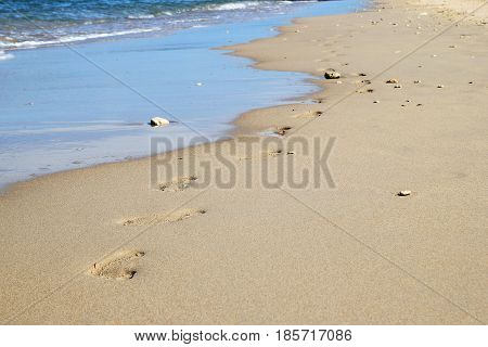 Travel To Island Koh Lanta, Thailand. The Footprints On The Sand Beach Near To Sea.