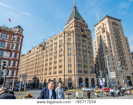 Shanghai, China - Nov 4, 2016: View of Former Palace (South Wing of the Peace) Hotel, Sassoon House and Bank of China buildings (left to right) along The Bund on Zhongshan East 1st Road.