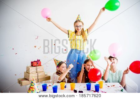 Four teen friends are celebrating birthday together at home