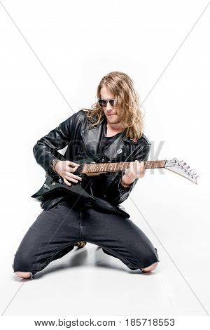 handsome rocker posing playing electric guitar isolated on white rock star guitar concept