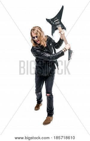 handsome rocker posing with electric guitar isolated on white rock star guitar concept