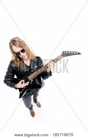 handsome rocker in posing playing electric guitar isolated on white electric guitar player concept