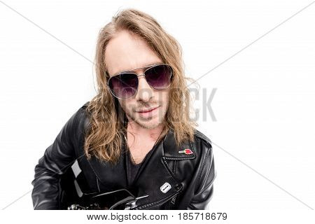 portrait of handsome rocker in black leather jacket and posing isolated on white