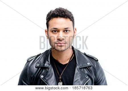 Portrait Of African American Rocker In Black Leather Jacket Posing Isolated On White
