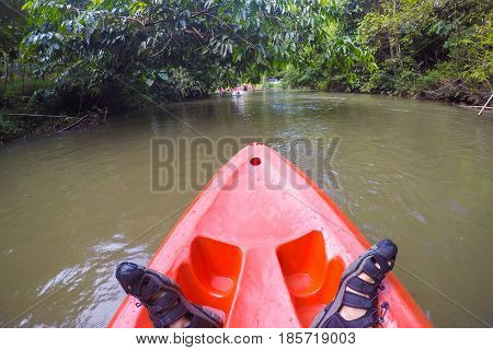 A whitewater kayaker while wave on the river in Satun province Thailand.