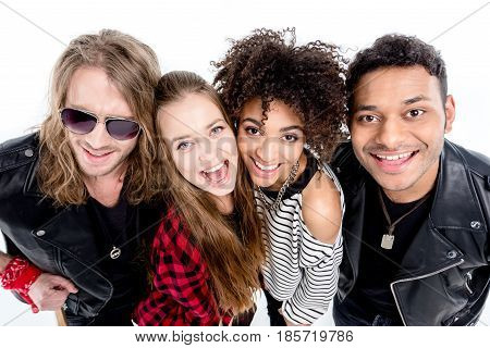 Close-up Portrait Of Happy Young Rock And Roll Band Smiling At Camera