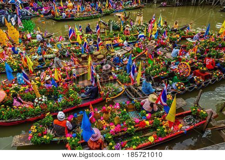 AYUTHAYA THAILAND - JULY 11, 2014: Buddhists do candle festival parade by boat at Ladchado canal in Ayuthaya Thailand .