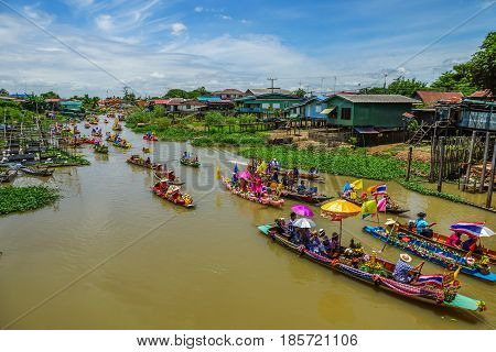 AYUTHAYA THAILAND - JULY 11, 2014 : Buddhists do candle festival parade by boat at Ladchado canal in Ayuthaya Thailand