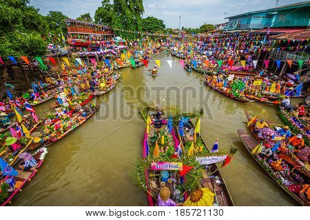 AYUTHAYA THAILAND - JULY 11 Buddhists do candle festival parade by boat at Ladchado canal in Ayuthaya Thailand on July 11 2014
