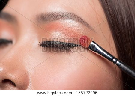 Beautiful Asian Woman Face With Perfect Makeup Applying Blusher.