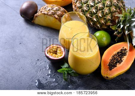 Healthy smoothie with tropical fruits pineapple papaya and passion fruit exotic vitamin drink