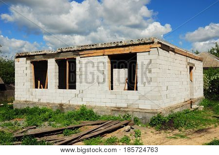 House building construction from autoclaved aerated concrete blocks. Unfinished house construction site.