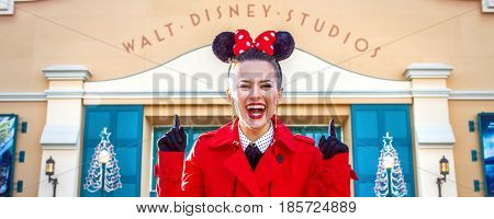 Woman In Front Of Disney Studio 1 Pointing Up At Inscription
