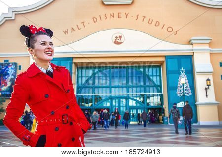 Happy Woman In Front Of Disney Studio 1 Looking Into Distance