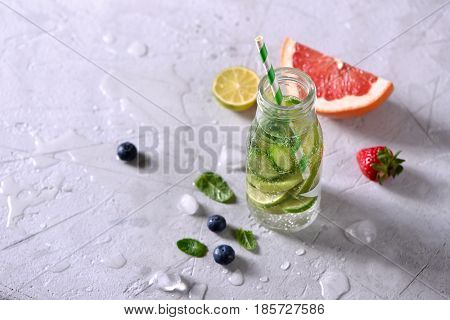 Infused detox water healthy refreshing drink with lime grapefruit berries and mint