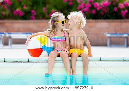 Kids Playing At Outdoor Swimming Pool